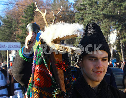 A young man in a goat costume
