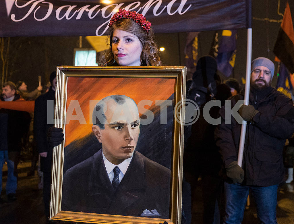 A girl holding a portrait of Bandera — Image 49690