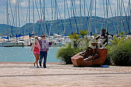 Holidaymakers on the background of yachts on Lake Balaton in Hungary