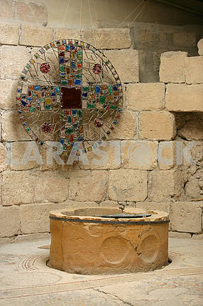 Mosaic cross at the well