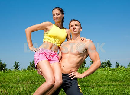 young athletic couple in the sky