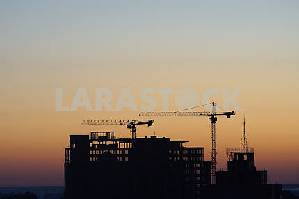 House under construction on a sunset background