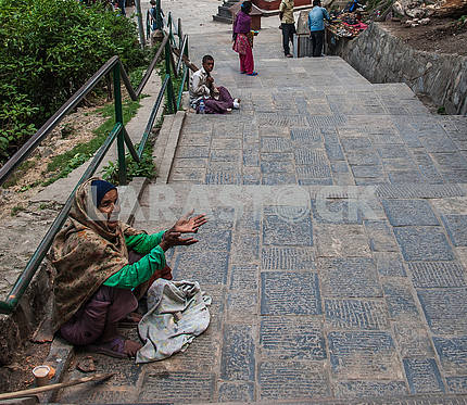 The beggars asking for alms on the steps to Swayambhunath Temple