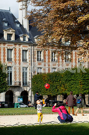 Boy playing ball in Place des Vosges