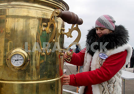 A girl near the samovar on the day of Epiphany