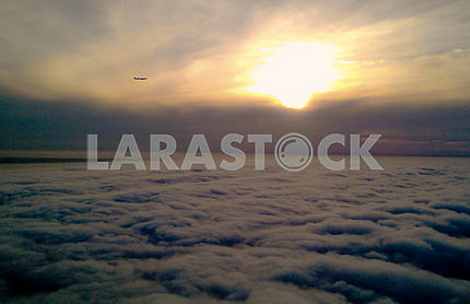 Airplane against the background of sunrise