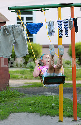Girl on a swing in Glukhov