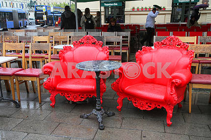 Red chairs in a street cafe in Munich