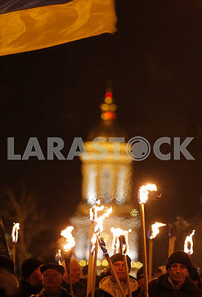 Torch against the background of the monastery