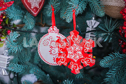 Pine-tree decoration stylish, red  and white snowflake, Christmas tree close-up