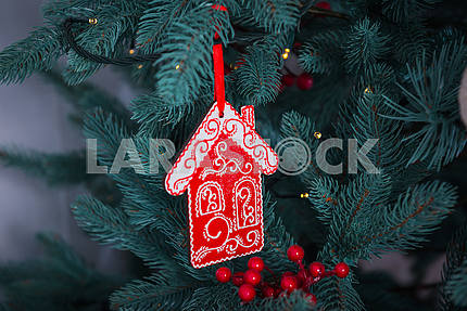 Pine-tree decoration stylish, red little house close-up