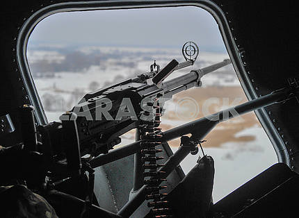 Machine gun in the helicopter