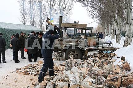 Співробітники ДСНС рують firewood