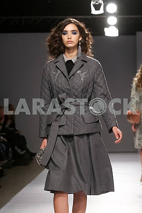 Show by V by Gres, model in gray suit