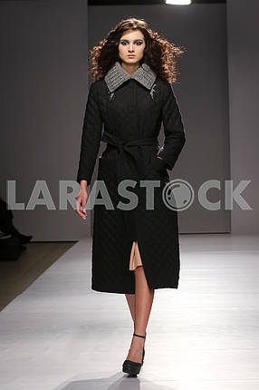 Display V by Gres, model in a black coat