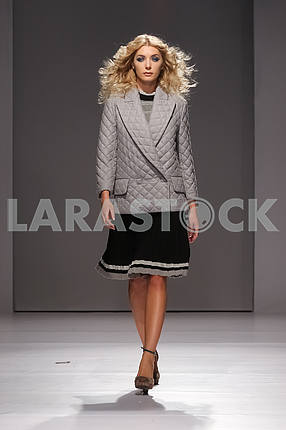 Display V by Gres, a girl in a gray-black suit
