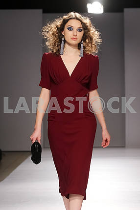 A girl in a marsala dress