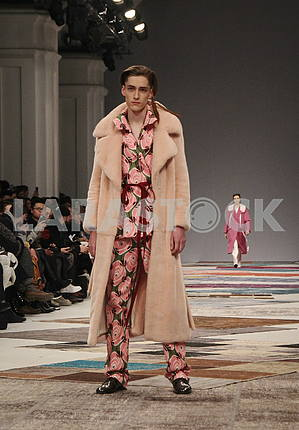 Model in a beige coat