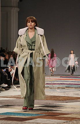 Model in an olive coat