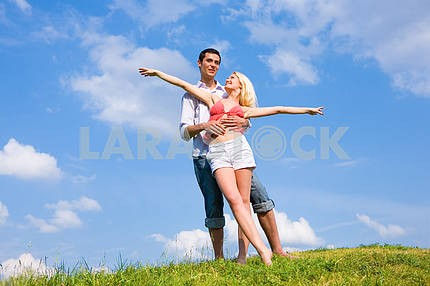 Young love couple having fun on spring meadow