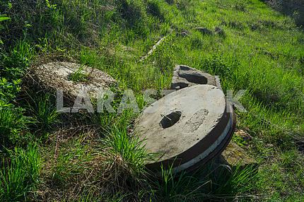 Abandoned mill millstones