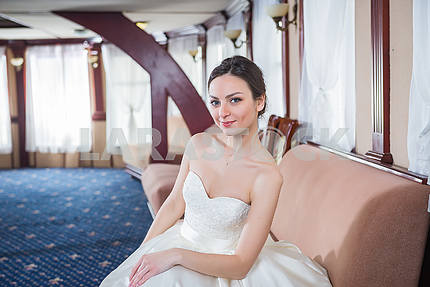 Brunette bride in a white dress