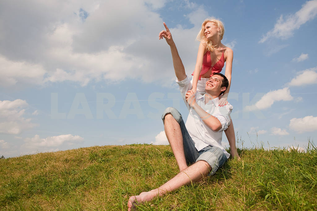 Happy young couple in sky above a green meadow — Image 5228