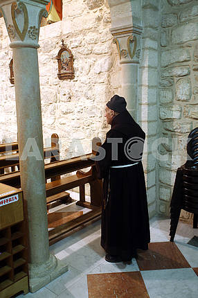 Franciscan monk in the Church of Jesus' first miracle, Cana