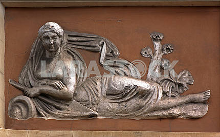 Female figure on the front of the house