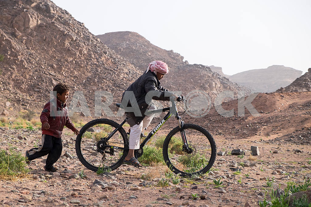 Boys Bedouins ride a bike — Image 52666