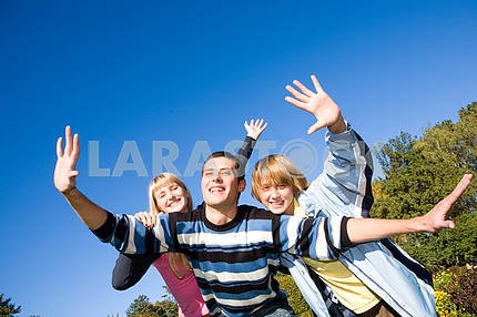 Happy funny people jumping end flies in blue sky