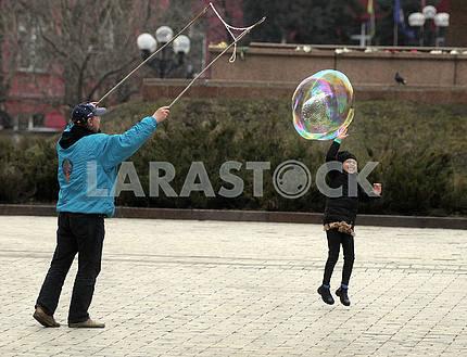 A man blows a soap bubble