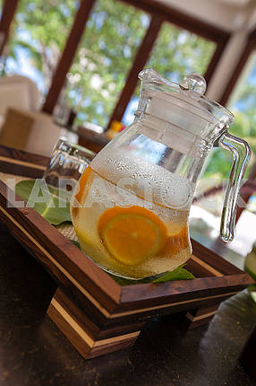 Lemonade with glass on table