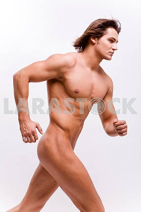 Muscular sexy Man with a naked torso isolated on white