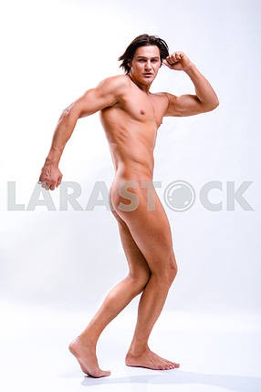 Sexy muscular man isolated on white. In all growth.