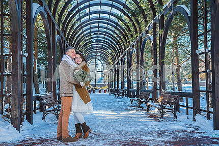 Wedding couple in a showy wither day, walking, geometry. rustic style  short wedding dress. Girl brunette. beautiful bride