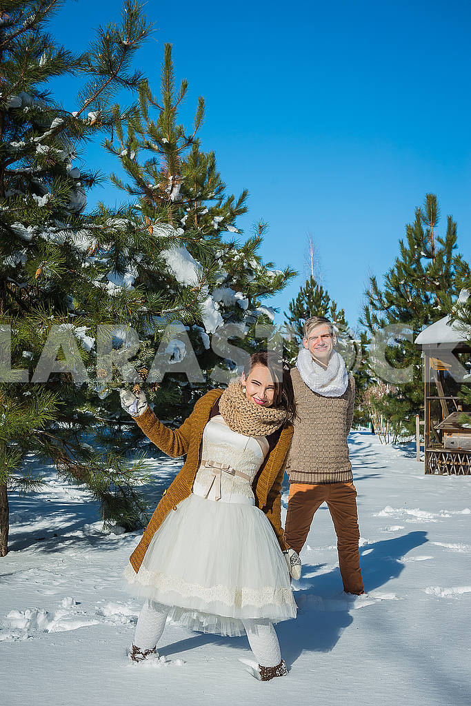 Wedding couple in a showy wither day, walking, having fun behind the ...