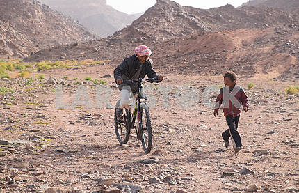 Boys Bedouins ride a bike