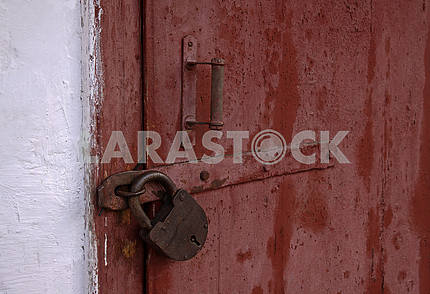 Wooden doors locked padlock