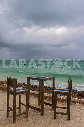 Table and chairs on the beach