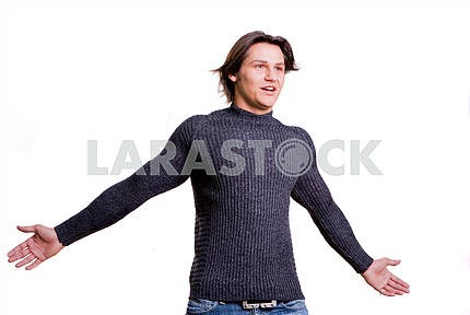 Young men dressed in modern clothes. In a sweater and jeans.