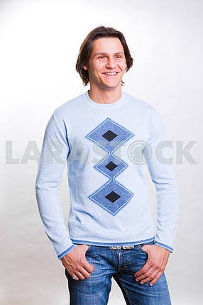 Young men dressed in modern clothes. In a sweater and jeans