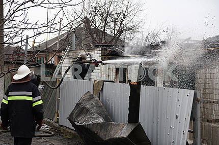 Rescuers extinguish a fire in Balakley