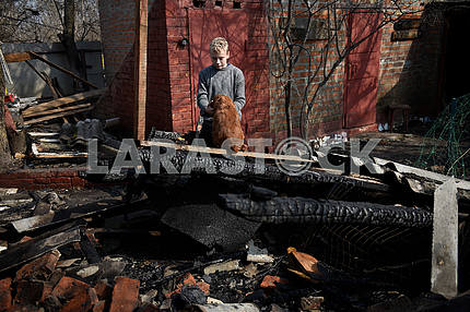 A boy with a dog at the conflagration in Balakley
