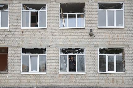 The broken windows of the school in Balakley