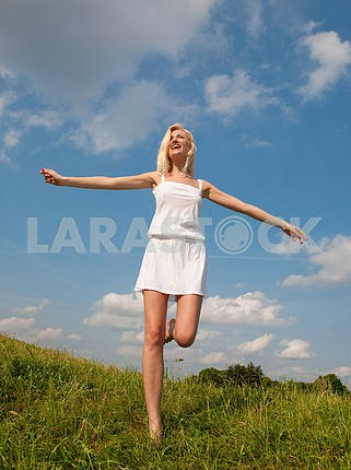 Happy young women runing in field