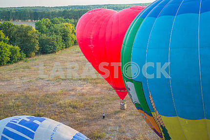 A view from high above - landsacape. little town and the horisont. Balloon flight. basket 1000 meters. having fun, romantic flight a multicoloread baloon and a big heart shape baloon