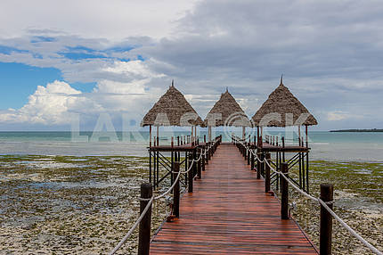 Wooden pier near the ocean on the island of Zanzibar