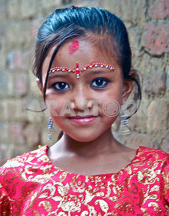 A girl with ritual tilaka