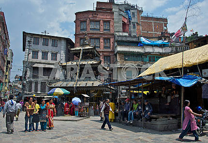 Streets of the ancient Kathmandu with an ancient temple